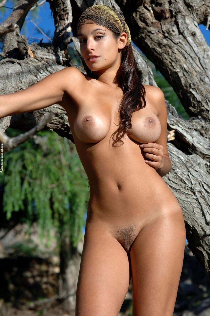 image Beautiful brunette dancing naked outdoors on balcony