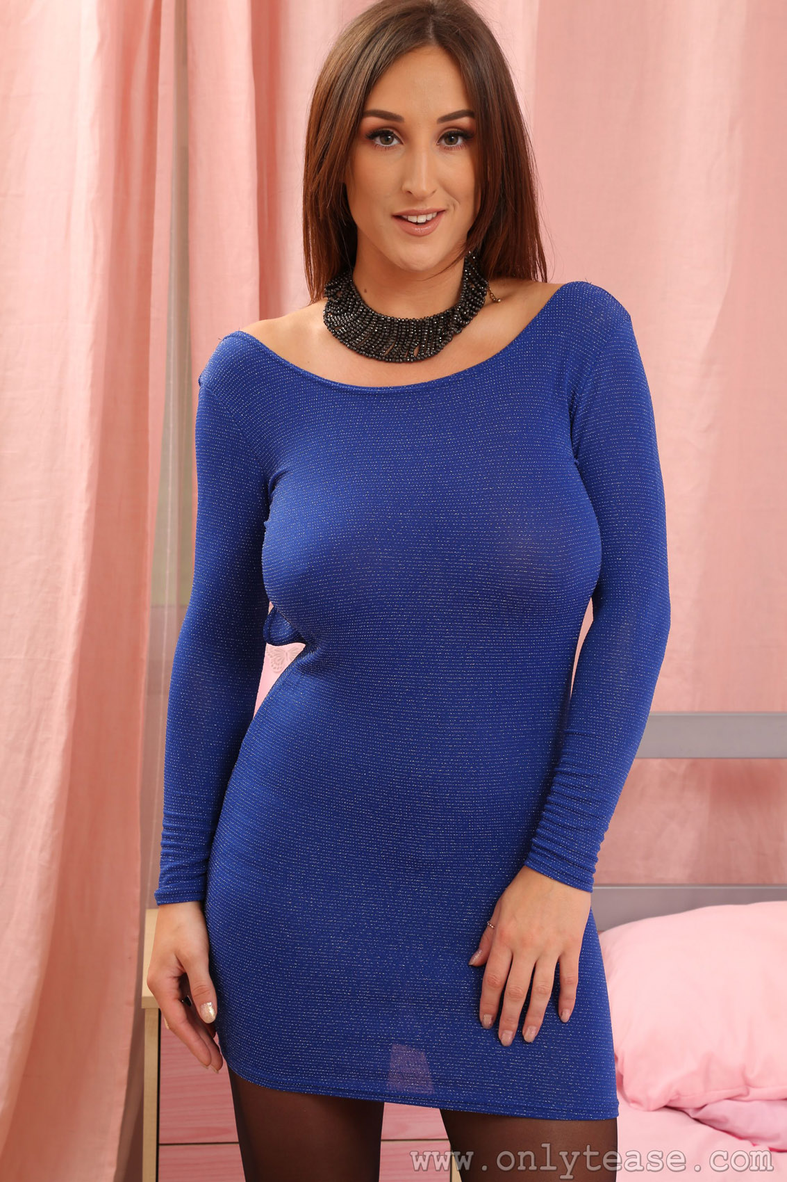 Busty blonde in blue dress